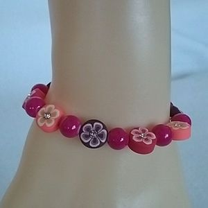 NWT Hot pink and flowers beaded bracelet